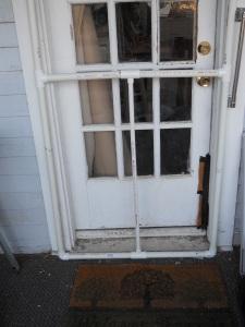 Bottom of screen door.